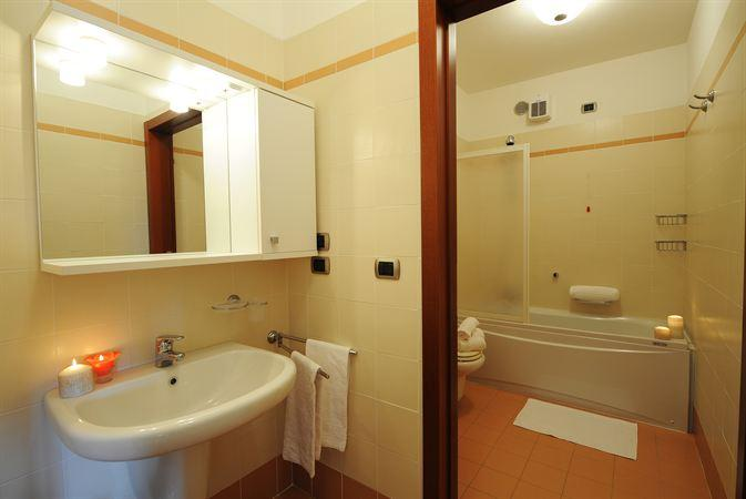 Two fully fitted bathrooms both with a bath tub and overhead shower