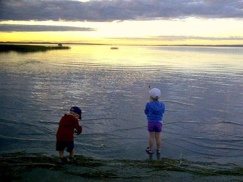 Children Fishing and Playing at the Beach
