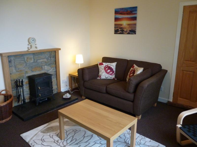 Lounge - with woodburner & caithness stone fireplace
