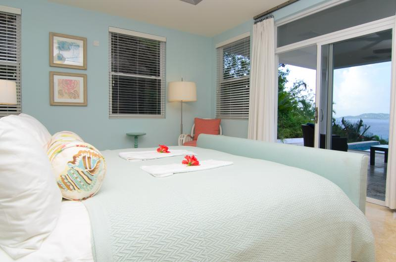 Bedroom 1 on the ground floor features a king size bed and en-suite bathroom with double vanity