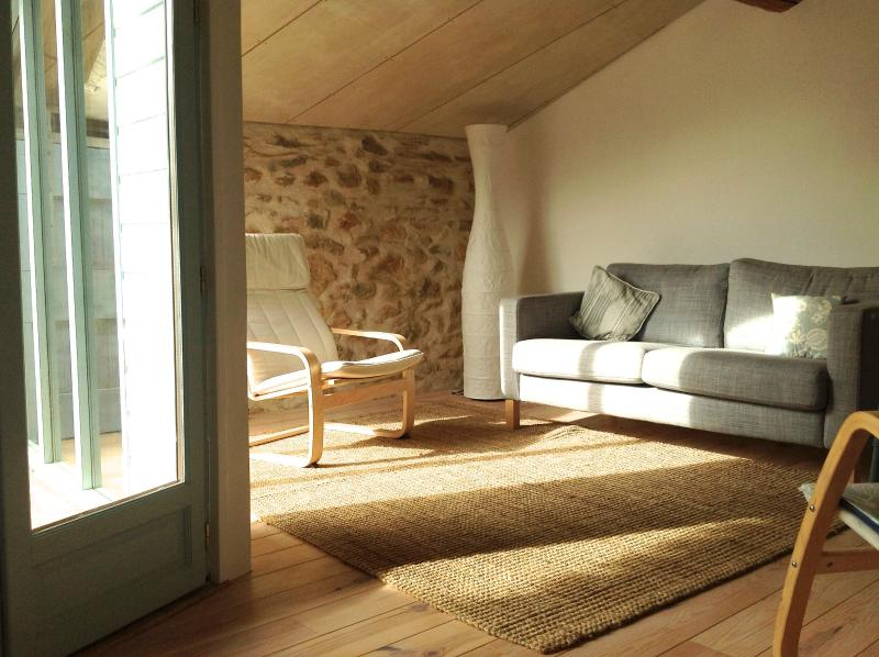 The sunny light and airy sitting room looking onto the terrace
