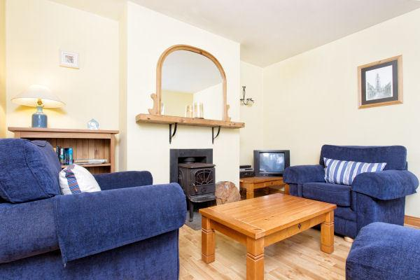 The cosy sitting room has a wood burning stove for winter evenings by the fire,