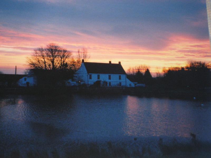 Hall Farmhouse from across the village pond at Sunset