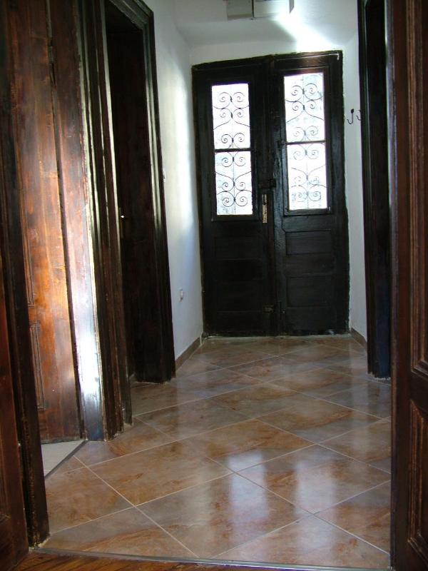 Spacious entrance hall with marble tiled floor