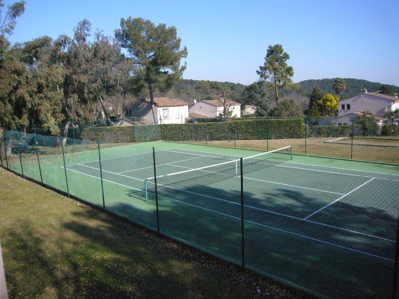 Two free private tennis courts available for use with boules pitch behind