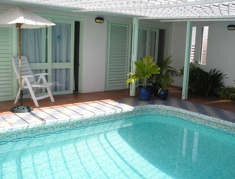 A view of the pool across looking towards the bedroom area