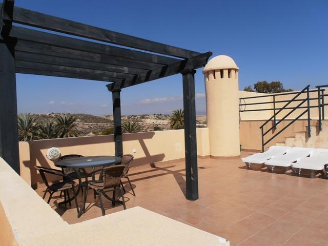 spacious roof top terrace with patio table and chairs, ideal for alfresco dining.