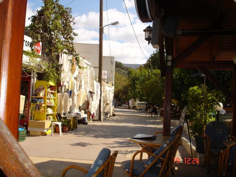 The main street showing the small traditional shops selling local produce