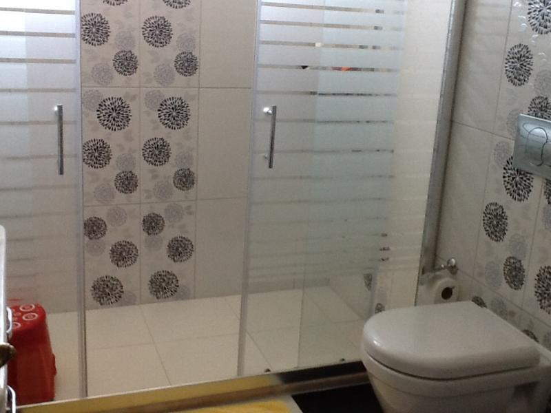 Main luxury bathroom, comprises of walk in shower, toilet and washbasin