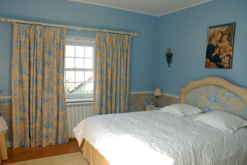 Master bedroom with window overlooking valley and sea