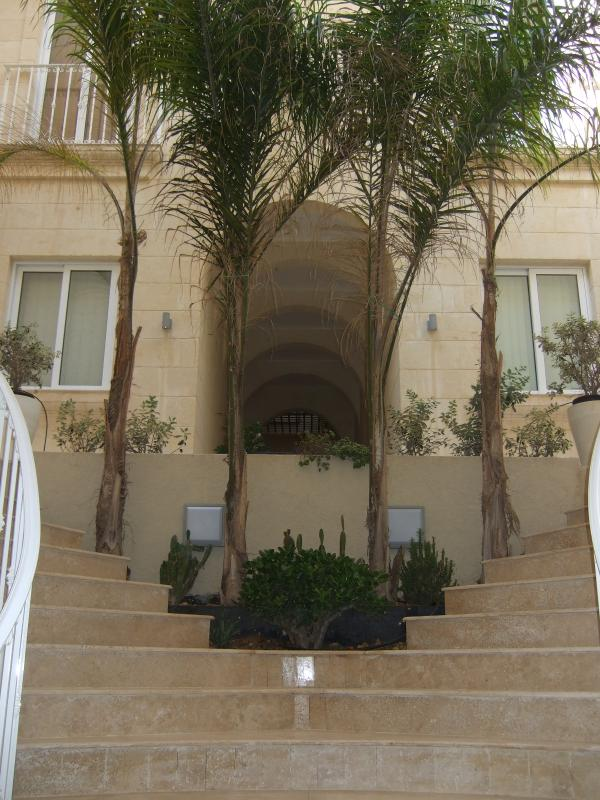 Stairs from main entrance leading down to the pool area