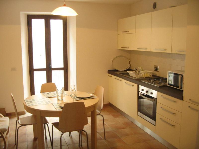 Kitchen diner with dishwasher, large fridge freezer, microwave, gas hob and electric oven