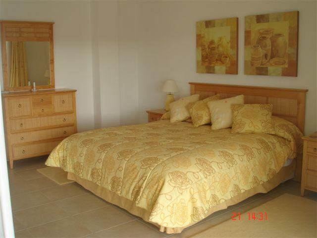 Main Bedroom with Super King size Bed and large outdoor terraces with sea views