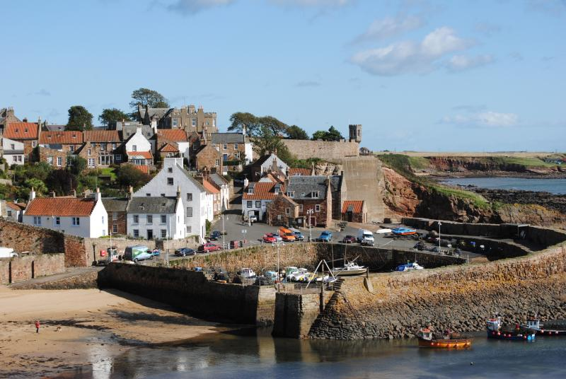 Harbour House is in the centre of the photo - up high and looking down onto the harbour & to the sea