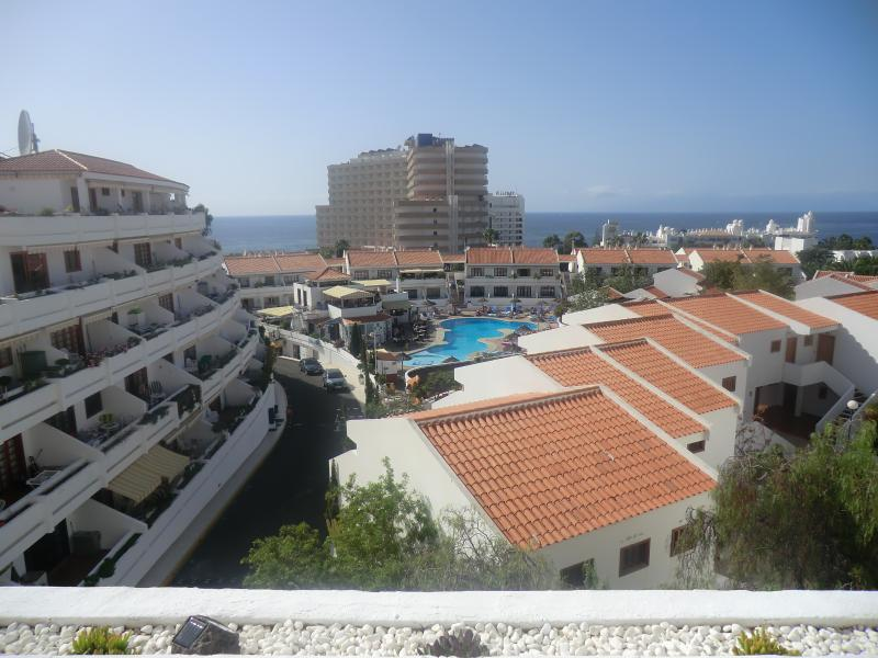 View of main pool area and sea from balcony