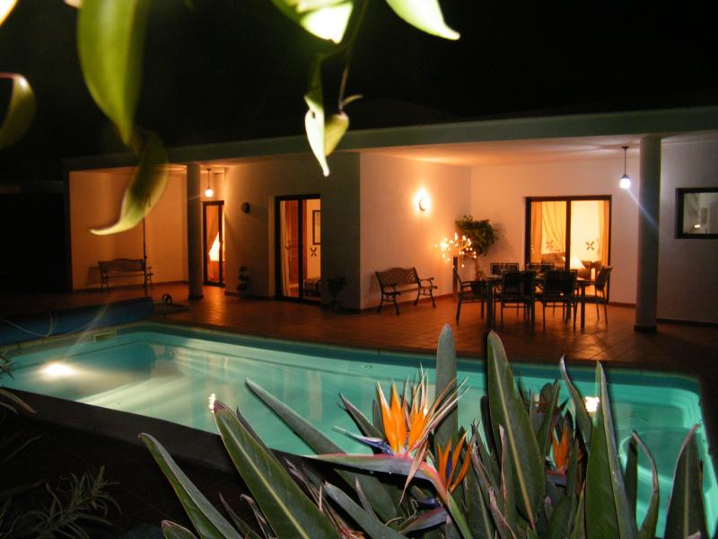 Located in an exclusive estate accessed only by code. An enticing pool and villa on a balmy evening.