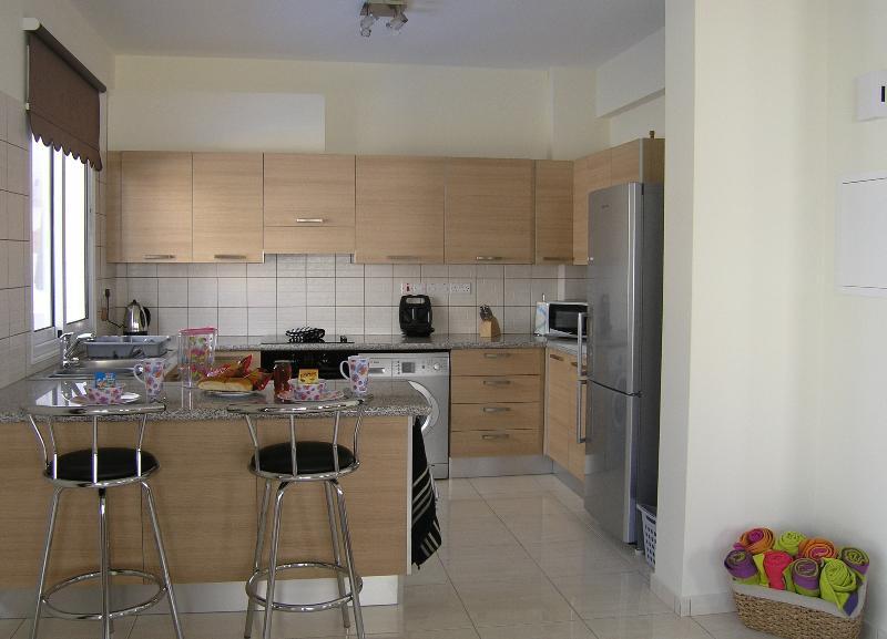 Modern kitchen with all appliances.