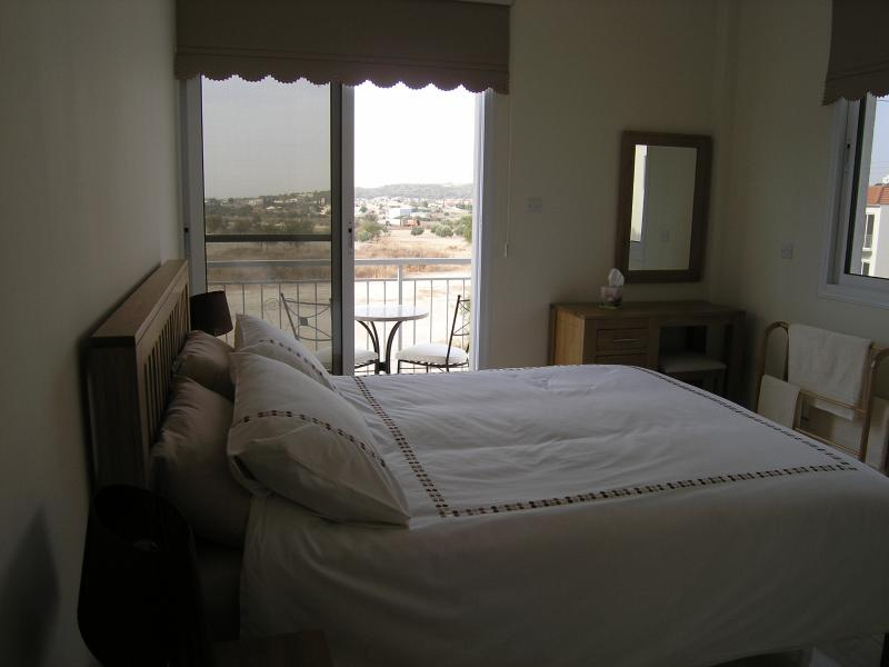 Master bedroom with balcony & open views.