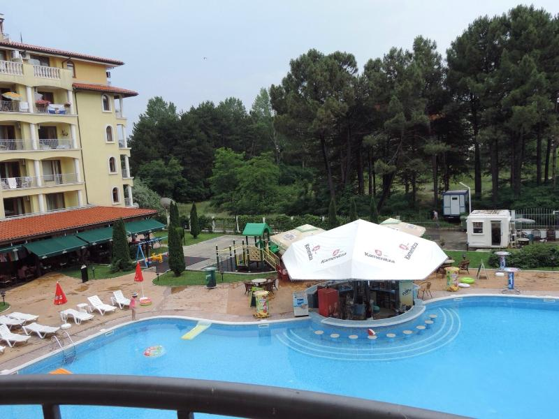 Pool bar and children's playground from balcony