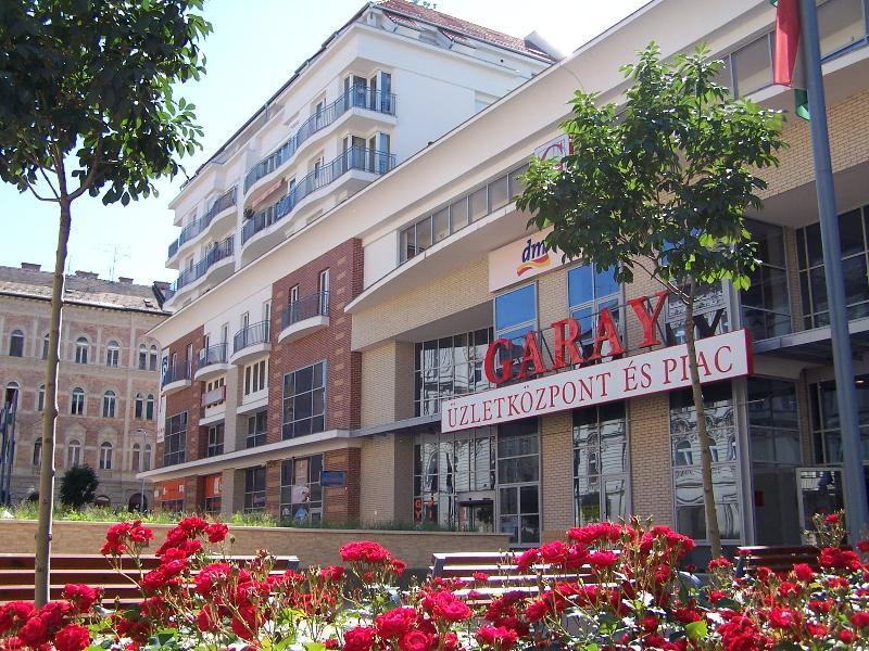 Garay Shopping Center - just in front of the apartment, with food market, shops, underground garage