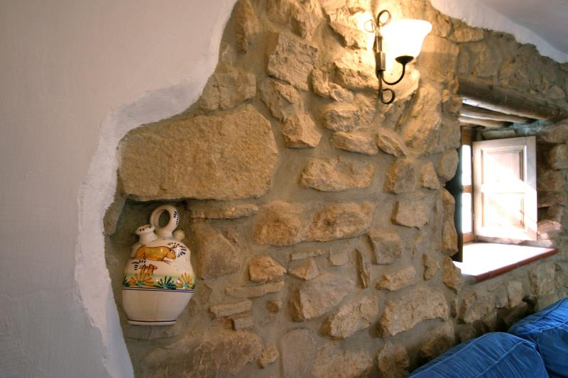 Exposed wall in farmhouse TV lounge - with local pottery preserved!