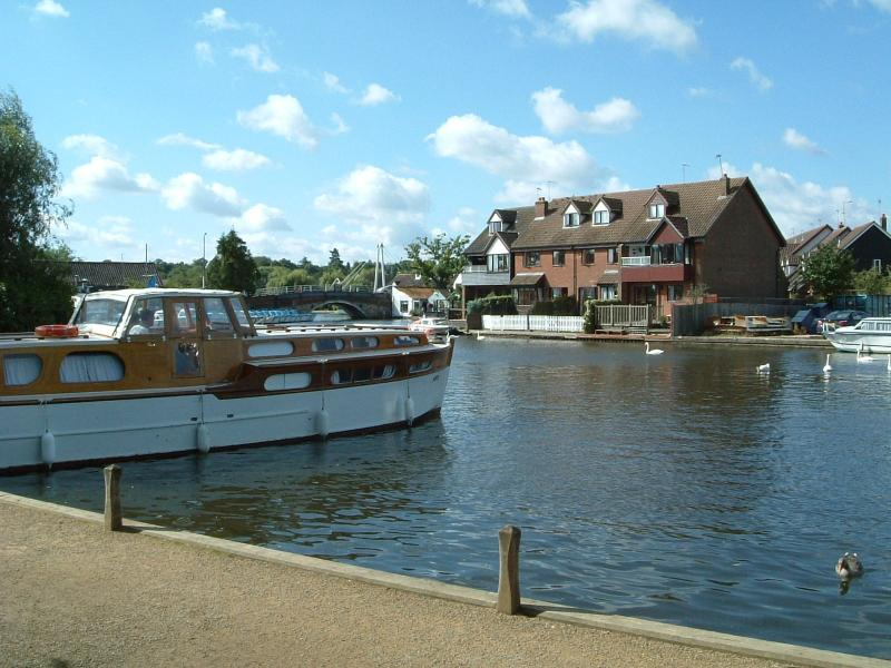 View of the Riverside & Anchor Cottages and River Bure from the boat moorings opposite