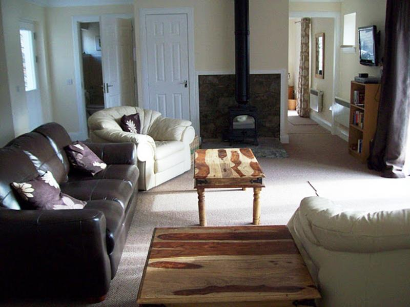 Open plan lounge with wood burning stove, Sky TV, DVD;s WiFi and games