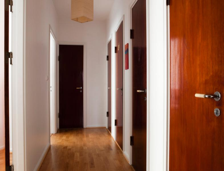 Hall with entrances to the two bedrooms, the bathroom, one of the separate toilets and two wardrobes