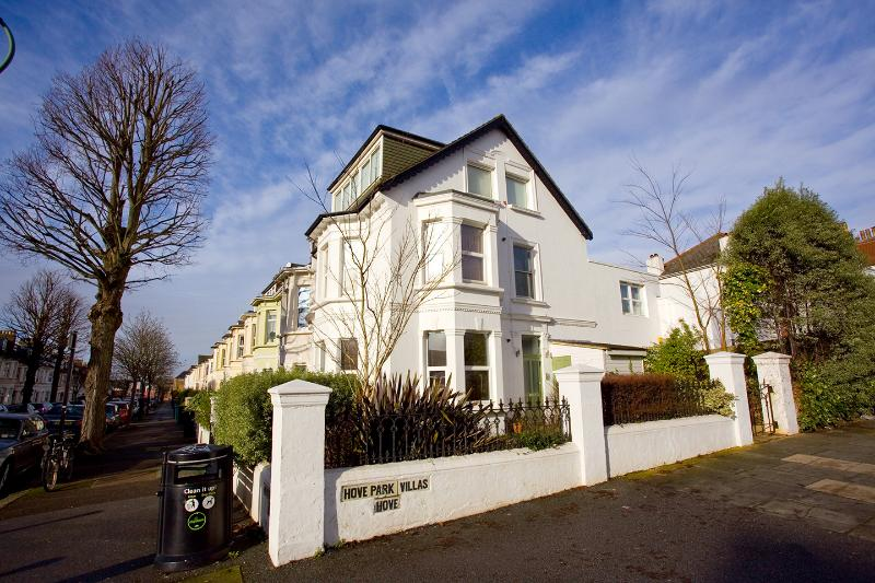 Garden Flat has double aspect front windows and sunny, mature lawned front garden