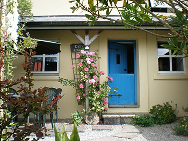 Gorgeous traditional style cottage with half-door, roses outside but modern conveniences inside!