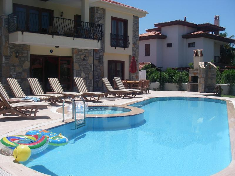 Pool, Jacuzzi , barbeque ,outside dining table and sun loungers.