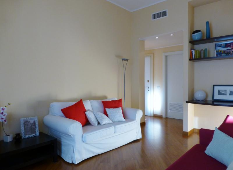 Living room, white sofa and red sofa bed on the right