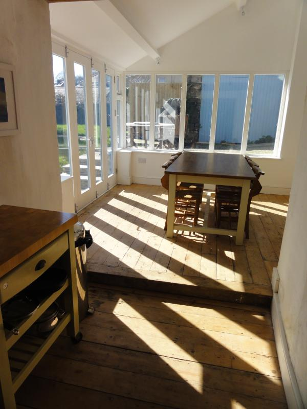 View from kitchen to glass extension and garden