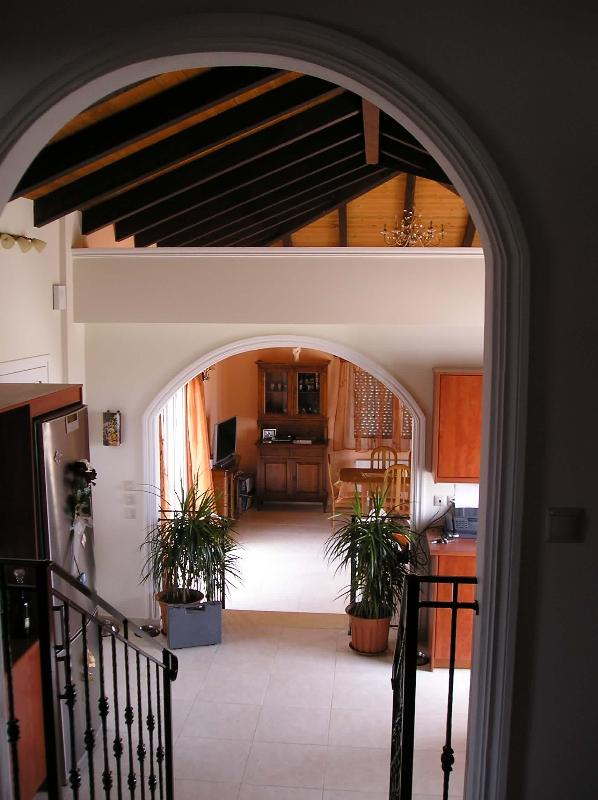 looking down from bedroom landing to the kitchen and lounge