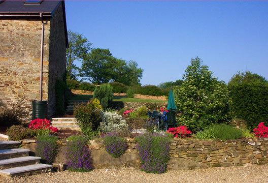 The courtyard garden which is shared by our three cottages