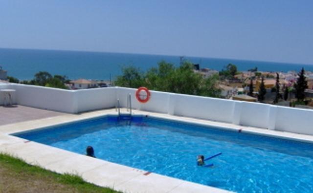 Communal Swimming Pool with sea views