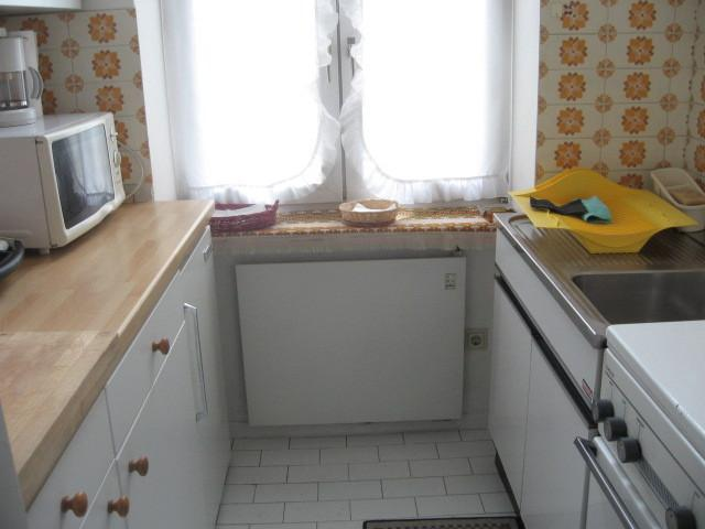 kitchen with hob, oven, microwave, electric grill and boiler