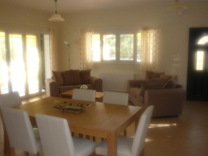 Part of the open plan living area which has a TV, Stereo and air conditioning