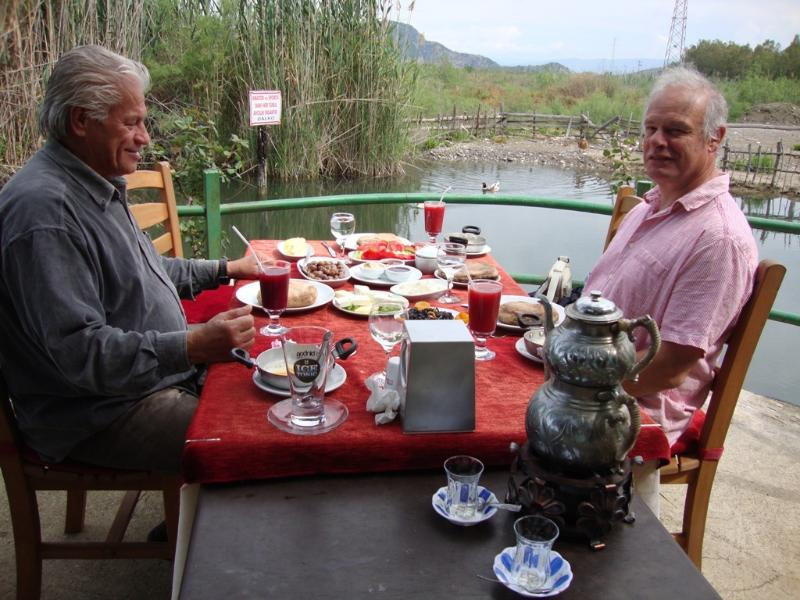 Eating your Turkish breakfast by the river on Day 1 of your holiday - courtesy of your villa owners!