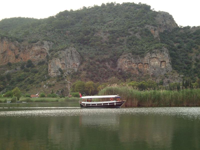 The ancient Lycian tombs of Kaunos in the cliffs of Dalyan river.