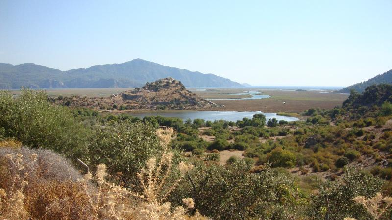 The Dalyan River meandering to the sea through the protected reed beds