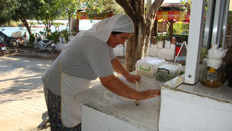 Lady making gozleme (traditional pancakes) Plus she'll row you across the river to visit Kaunos