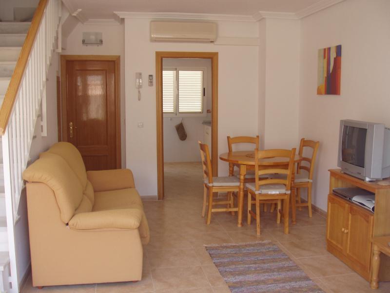 Spacious, comfortable lounge/dining room through to kithcen