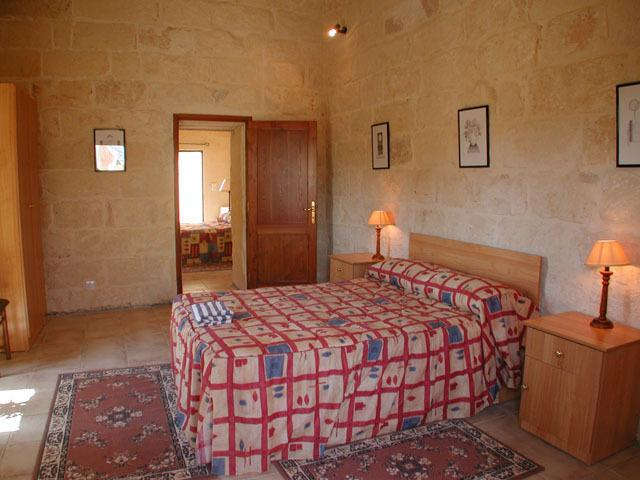kingsize double bed on first floor with ensuite and a/c