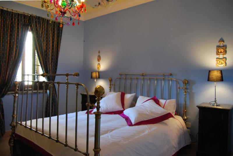 one of the bedrooms in the main house