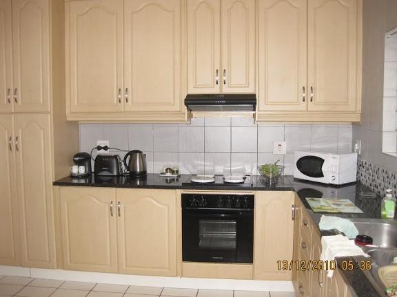 The kitchen - open plan to TV lounge. Separate laundry. Dishwasher, washing machine, coffee maker.