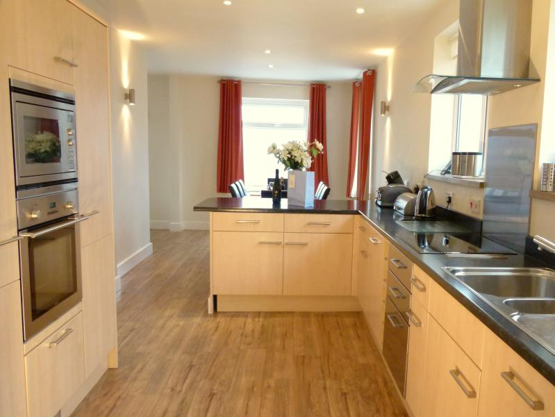 Kitchen showing windows with views over Swanage