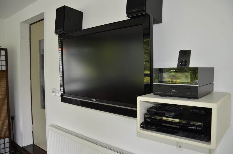 A 42 inch TV with Freesat, DVD player and iPod/mp3/CD player