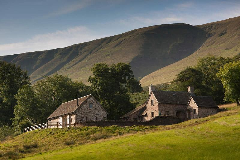 Panoramic view of house and barn with the Black Mountains in the backround