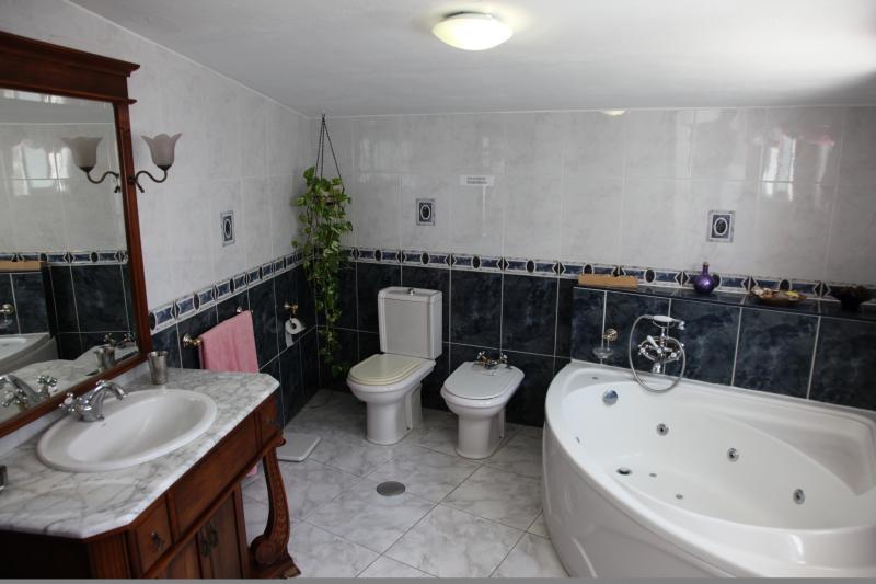 En suite bathroom with jacuzzi bath